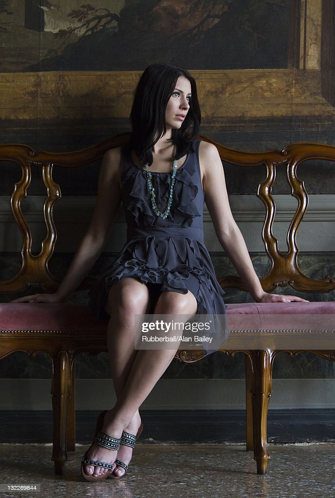 Italy, Venice, Young woman sitting in luxury room : Stock Photo