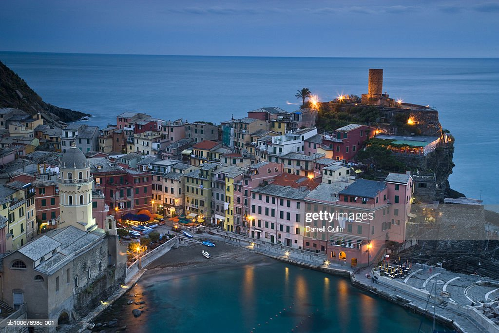 Italy, Vernazza, Cinque Terre, elevated view of city at dusk : Stock Photo
