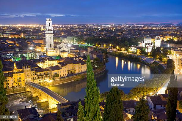 Italy, Verona, Adige River and cityscape at dusk, elevated view