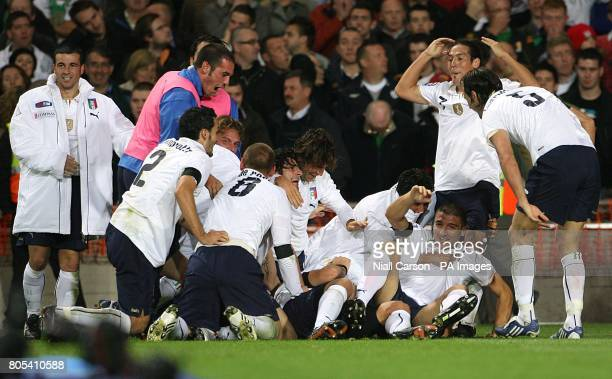 Italy's Alberto Gilardino is mobbed by his teammates after scoring a late equaliser