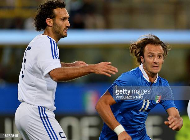 Italy's Alberto Gilardino vies with Alessandro Della Valle of San Marino during their friendly football match at Dall'Ara stadium in Bologna on May...