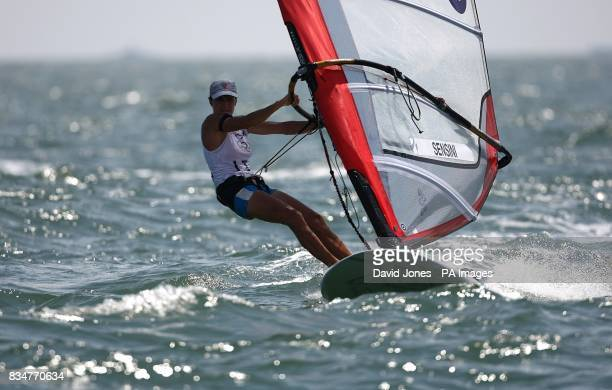 Italy's Alessandra Sensini sails in the final round of the Women's RSX Sailing Competition at the Olympic Games' Sailing Centre in Qingdao on day 12...