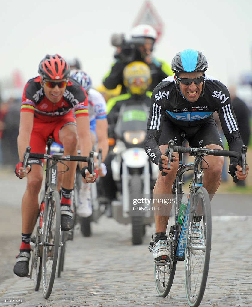 Italy's Alessandro Ballan (L-Team BMC) and Spain's Juan Antonio Flecha of team Sky ride on a cobblestoned road during the 110th edition of the Paris-Roubaix one-day classic cycling race, on April 8, 2012, in Roubaix, northern France. Boonen, who had previously won in 2005, 2008 and 2009, equals the record of wins in Paris-Roubaix held by compatriot Roger De Vlaeminck. Boonen won the race ahead of French Sebastien Turgot (Team Europcar) and Italian Alessandro Ballan (Team BMC).