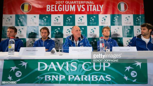 Italy's Alessandro Giannessi Italian Paolo Lorenzi Italian captain Corrado Barazzutti Italian Andreas Seppi and Italian Simone Bolelli speak during a...