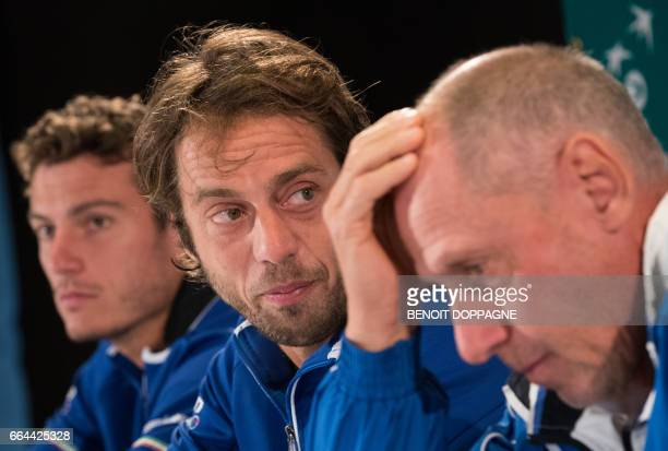 Italy's Alessandro Giannessi Paolo Lorenzi and captain Corrado Barazzutti take part in a press conference ahead of the Davis Cup World Group...