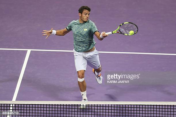 Italy's Alessandro Giannessi returns the ball to Czech player Tomas Berdych on the fourth day of the ATP Qatar Open tennis competition in Doha on...