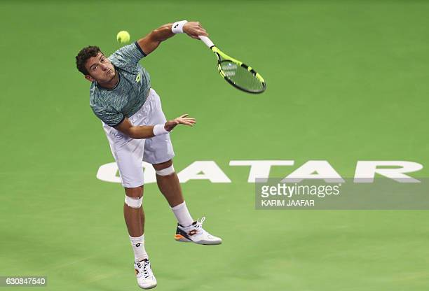 Italy's Alessandro Giannessi serves the ball to Czech player Tomas Berdych on the fourth day of the ATP Qatar Open tennis competition in Doha on...