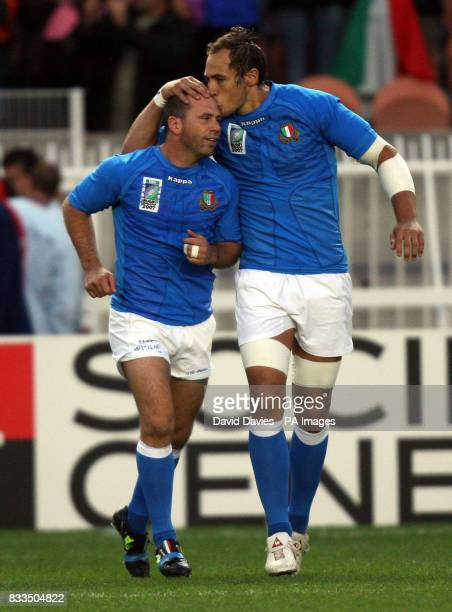 Italy's Alessandro Troncon recieves a kiss on the head from Sergio Parisse as he takes the field to win his 100th cap against Portugal during the...