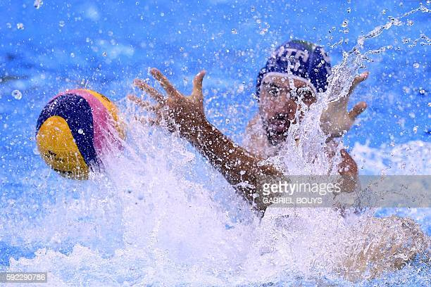 Italy's Andrea Fondelli vies for the ball during their Rio 2016 Olympic Games waterpolo Bronze medal match on August 20 2016 at the Olympic Aquatics...