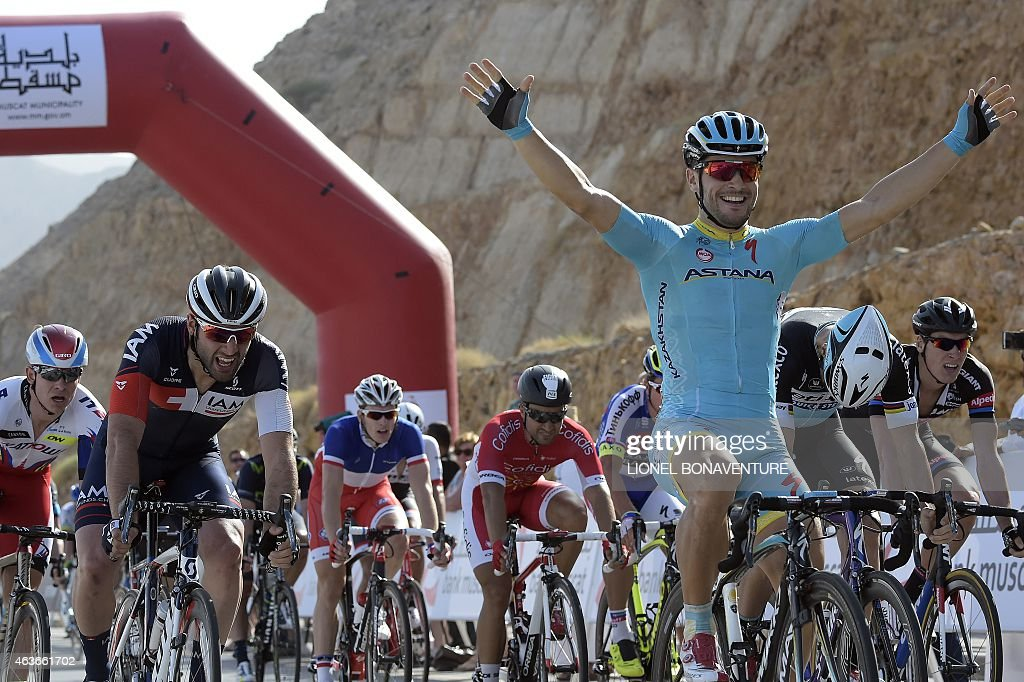 Italy's Andrea Guardini celebrates as he crosses the finish line after winning the first stage of the Tour of Oman from Bayt AlNaman castle to...