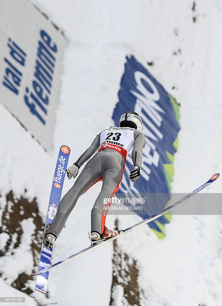 Italy's Andrea Morassi soars through the air on February 27, 2013 during the Large Hill Individual qualification race of the FIS Nordic World Ski Championships at the Ski Jumping stadium in Predazzo, northern Italy.