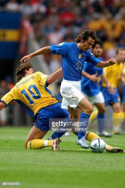 Italy's Andrea Pirlo goes past Sweden's Zlatan Ibrahimovic