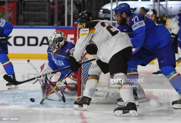 Italy´s Andreas Bernard Italy´s Thomas Larkin and Germany´s Leon Draisaitl vie during the IIHF Ice Hockey World Championships first round match...