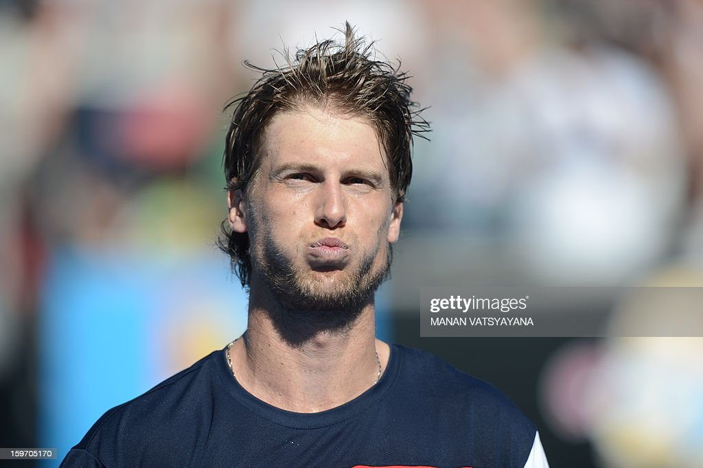 Italy's Andreas Seppi gestures as he celebrates after victory in his men's singles match against Croatia's Marin Cilic on the sixth day of the Australian Open tennis tournament in Melbourne on January 19, 2013.