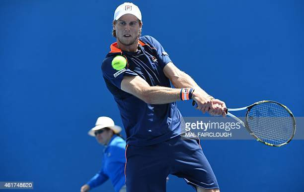 Italy's Andreas Seppi hits a return against Uzbekistan's Denis Istomin during their men's singles match on day one of the 2015 Australian Open tennis...