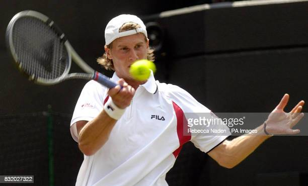 Italy's Andreas Seppi in action against USA's Andre Agassi during the second round of The All England Lawn Tennis Championships at Wimbledon