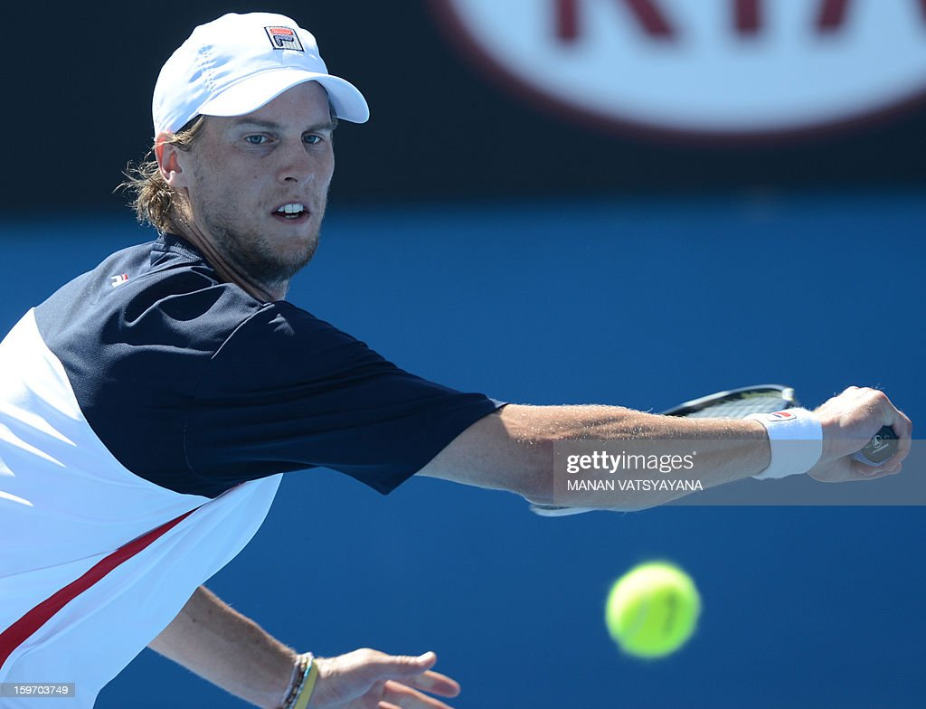 Italy's Andreas Seppi plays a return during his men's singles match against Croatia's Marin Cilic on the sixth day of the Australian Open tennis tournament in Melbourne on January 19, 2013.