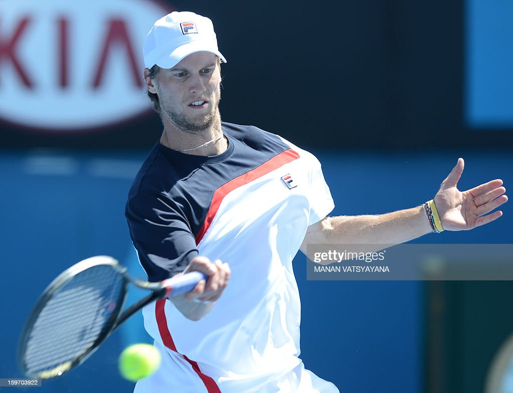 Italy's Andreas Seppi plays a return during his men's singles match against Croatia's Marin Cilic on the sixth day of the Australian Open tennis tournament in Melbourne on January 19, 2013. AFP PHOTO/MANAN VATSYAYANA IMAGE STRICTLY RESTRICTED TO EDITORIAL USE - STRICTLY NO COMMERCIAL USE