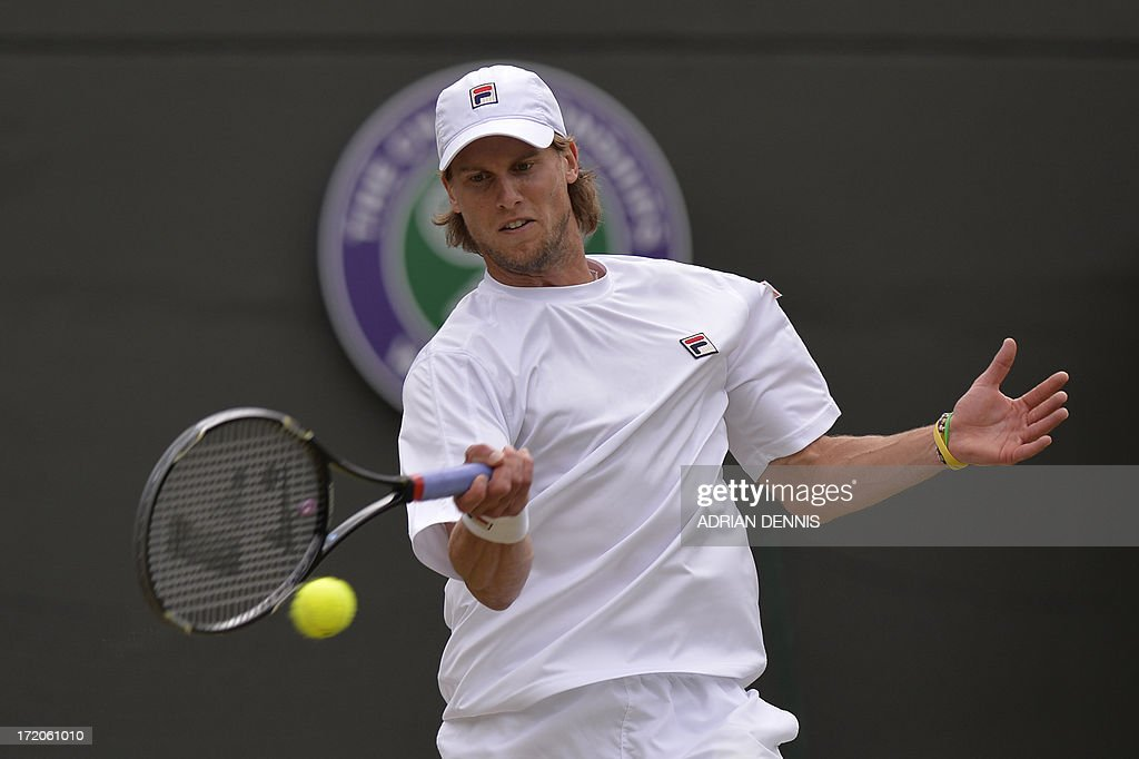 Italy's Andreas Seppi returns against Argentina's Juan Martin Del Potro during their fourth round men's singles match on day seven of the 2013 Wimbledon Championships tennis tournament at the All England Club in Wimbledon, southwest London, on July 1, 2013.