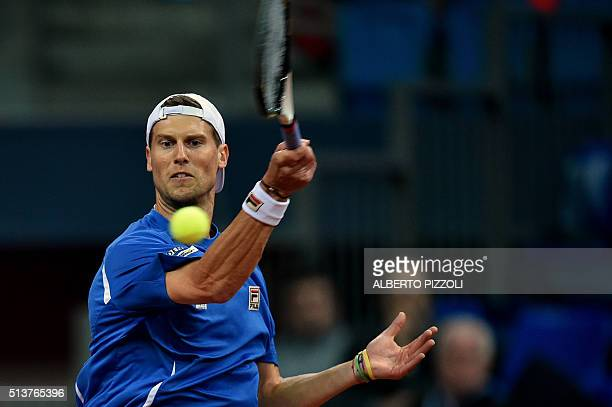 Italy's Andreas Seppi returns the ball to Swiss Henri Laaksonen during the first day of the Davis Cup first round World Group between Italy and...