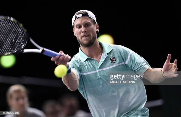 Italy's Andreas Seppi returns the ball to Switzerland's Roger Federer during their second round tennis match at the ATP World Tour Masters 1000...