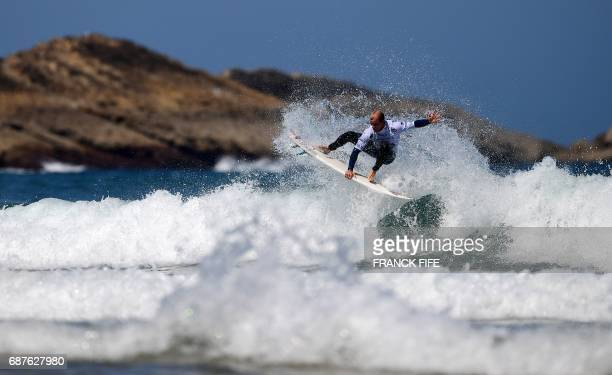 TOPSHOT Italy's Angelo Bonomelli competes during the heat 65 Round 2 on May 24 2017 in Biarritz southwestern France during the 2017 ISA World Surfing...