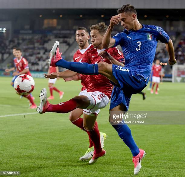 Italy's Antonio Barreca and Denmark's Andrew Hjulsager vie for the ball during the UEFA U21 European Championship Group C football match Italy versus...