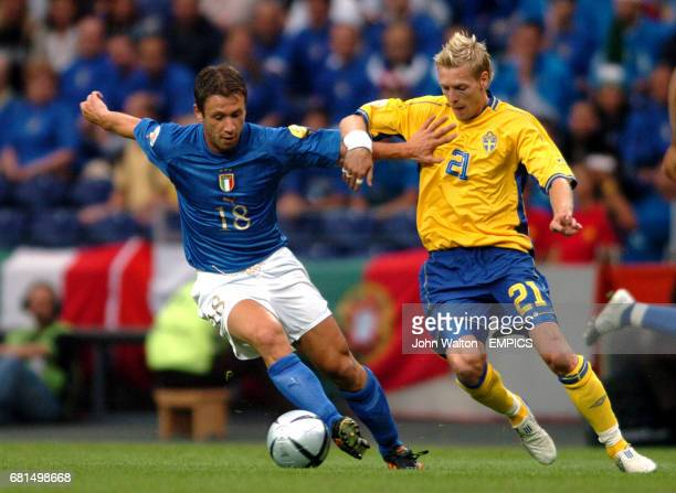 Italy's Antonio Cassano and Sweden's Christian Wilhelmsson battle for the ball