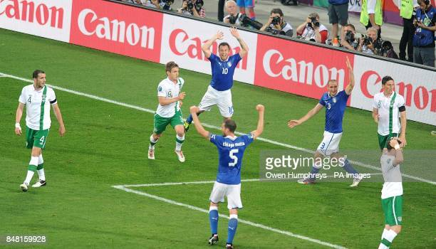 Italy's Antonio Cassano celebrates after he scores the opening goal of the game