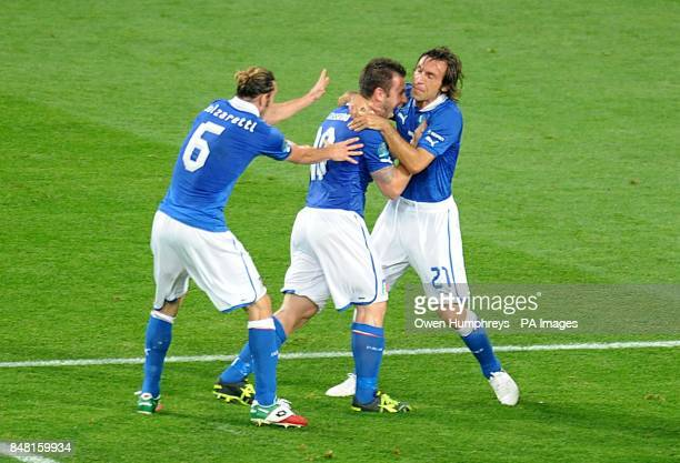 Italy's Antonio Cassano celebrates with team mates Andrea Pirlo and Federico Balzaretti after he scores the opening goal of the game