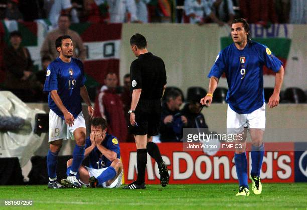 Italy's Antonio Cassano is dejected after scoring the winning goal only to realise his side would still be knocked out of the tournament