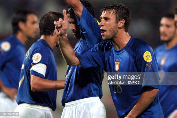 Italy's Antonio Cassano orgenises a defensive wall