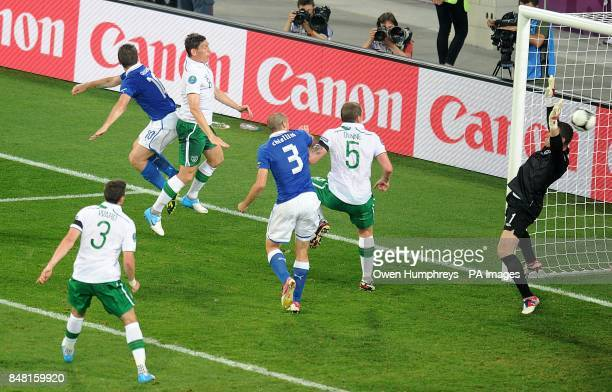 Italy's Antonio Cassano scores the opening goal of the game