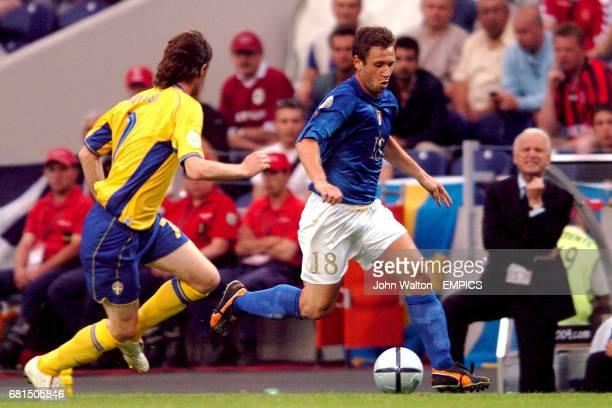Italy's Antonio Cassano takes on Sweden's Mikael Nilsson