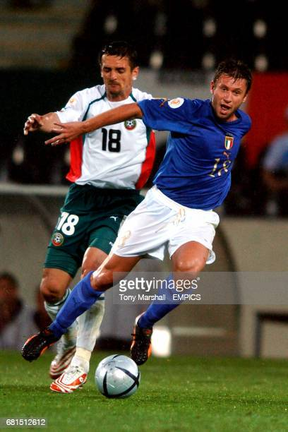 Italy's Antonio Cassano wins the ball ahead of Bulgaria's Predrag Pazin