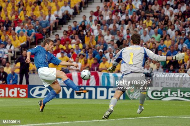 Italy's Antonio Cassano wins the ball ahead of Sweden goalkeeper Andreas Isaksson