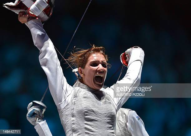 Italy's Arianna Errigo celebrates her victory over Italy's Valentina Vezzali at the end of their women's foil fencing semifinal bout as part of the...