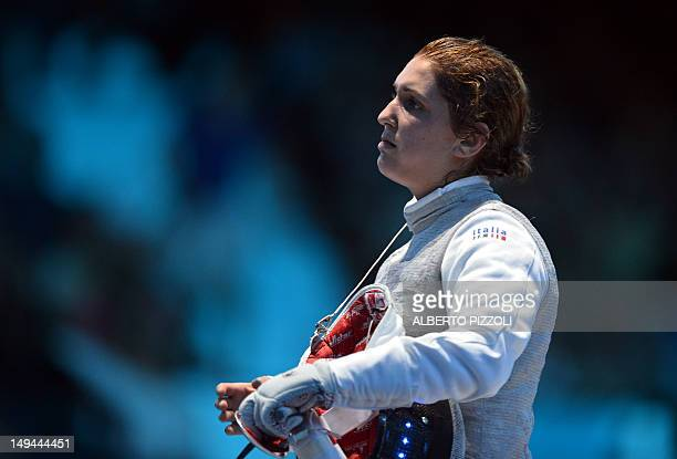 Italy's Arianna Errigo reacts after being defeated by Italy's Elisa Di Francisca at the end of their women's foil gold medal fencing bout as part of...