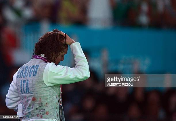 Italy's Arianna Errigo reacts after her defeat against Italy's Elisa Di Francisca at the end of their women's foil gold medal fencing bout as part of...