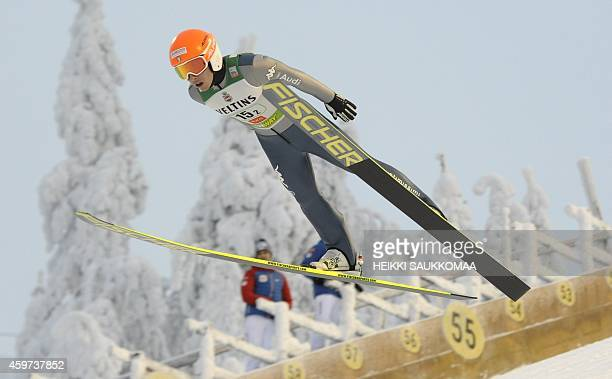 Italy's Armin Bauer soars through the air during the Nordic Combined team sprint's ski jumping competition at the FIS World Cup Ruka Nordic Opening...