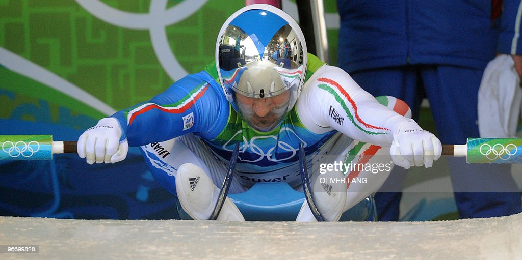 Italy's Armin Zoeggeler prepares to take the start of the men's luge singles run 3 at the Whistler sliding centre on February 14, 2010 during the Vancouver Winter Olympics.