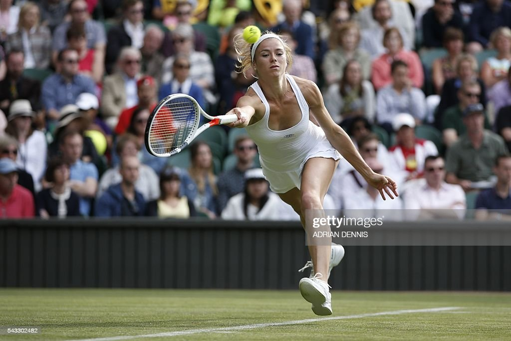 Italy's Camila Giorgi returns against Spain's Garbine Muguruza during their women's singles first round match on the first day of the 2016 Wimbledon Championships at The All England Lawn Tennis Club in Wimbledon, southwest London, on June 27, 2016. / AFP / ADRIAN