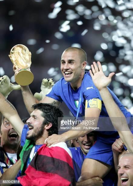 Italy's captain Fabio Cannavaro celebrates with the trophy