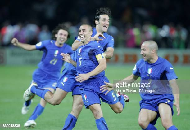 Italy's captain Fabio Cannavaro leads the celebrations after victory over France