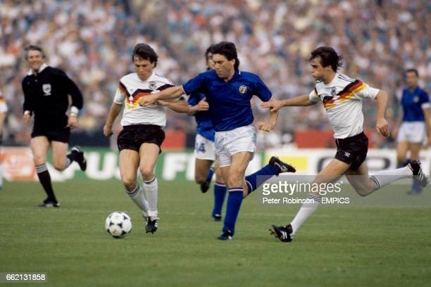 Italy's Carlo Ancelotti tries to burst between West Germany's Lothar Matthaus and Thomas Berthold