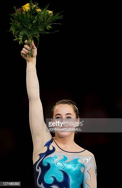 Italy's Carlotta Ferlito celebrates on the podium during a victory ceremony for the beam event at the 4th European Artistic Gymnastics Championships...
