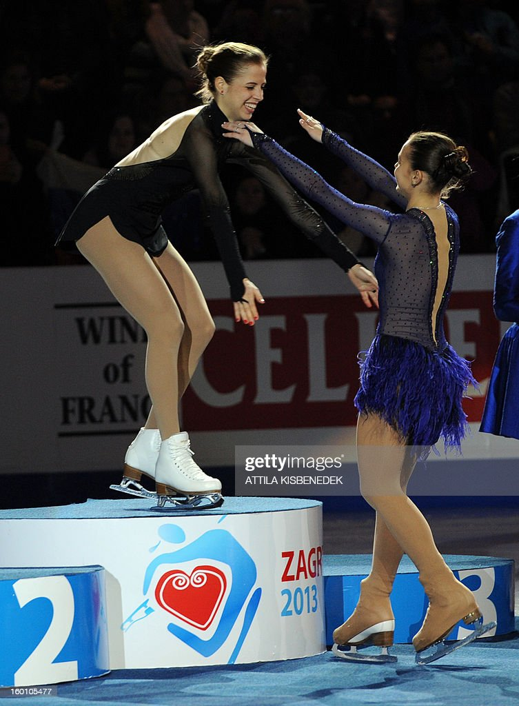 Italy's Carolina Kostner (L) is congratulated by Russia's Adelina Sotnikova (R) on the podium of the 'Dom Sportova' sports hall in Zagreb on January 26, 2013 after the women free skating event of the ISU European Figure Skating Championships. Kostner won the event and Sotnikova won the silver. AFP PHOTO / ATTILA KISBENEDEK