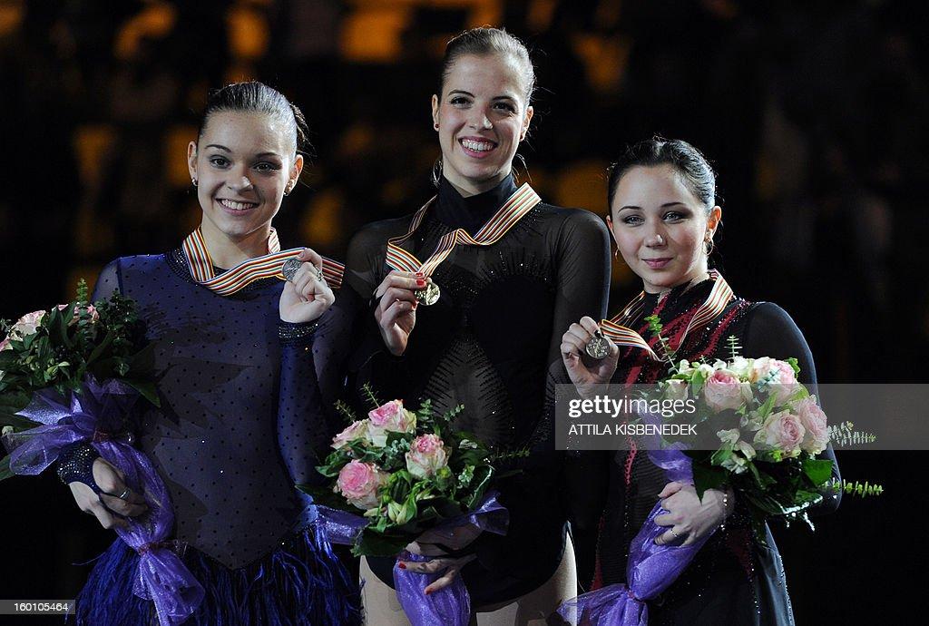 Italy's Carolina Kostner (C) poses flanked by Russia's Adelina Sotnikova (L) and Elizaveta Tuktamysheva (R) on the podium of the 'Dom Sportova' sports hall in Zagreb on January 26, 2013 after the women free skating event of the ISU European Figure Skating Championships. Kostner won the event, Sotnikova placed second and Tuktamysheva won the bronze.