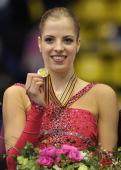 Italy's Carolina Kostner shows her gold medal on the podium after the free skating program at the Dom Sportova Arena in Zagreb 26 January 2008 during...