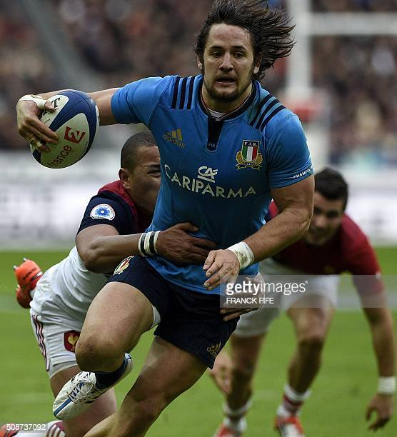 Italy's centre Michele Campagnaro is tackled by France's centre Gael Fickou during the Six Nations international rugby union match between France and...